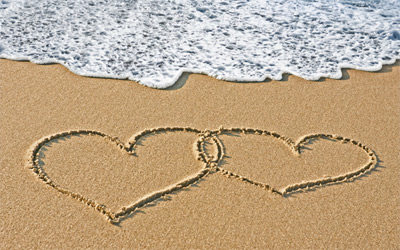 2 hearts in the sand on the beach
